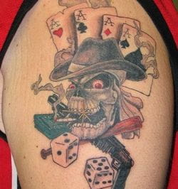 Smoking skull gambling tattoo